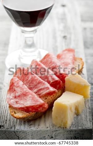 slice bread with salami  grana and wine - stock photo
