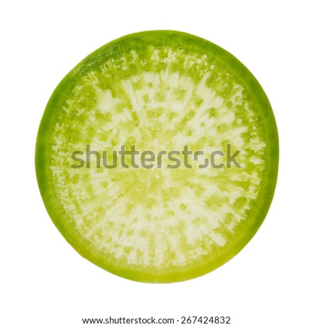 Slice green radish on an isolated background in macro scale - stock photo