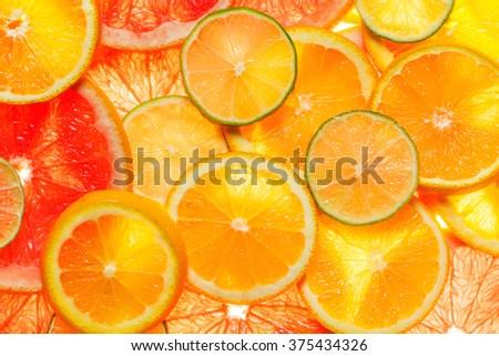 Slice of a fresh juicy round citrus fruits  - stock photo