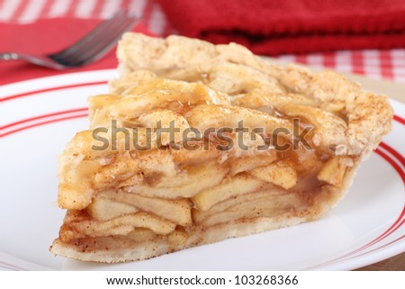 Slice of apple fruit pie on a plate - stock photo