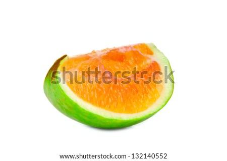 Slice of apple with orange pulp - stock photo