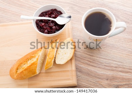 Slice of baguette with cherry jam - stock photo