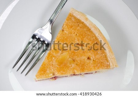 Slice of bakewell tart with fork from above