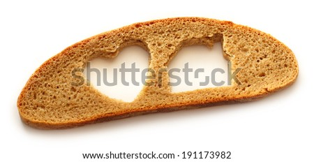 Slice of bread in house and heart form on white