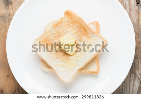Slice of bread toast on a white plate. Top view. - stock photo
