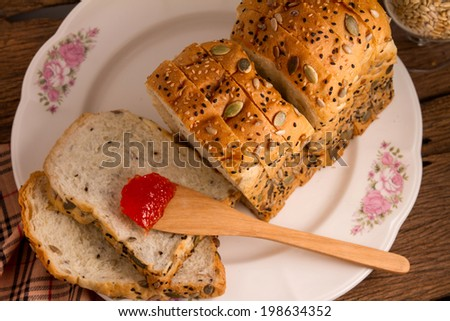 Slice of bread with sunflower seeds. - stock photo