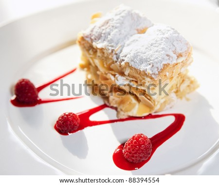 Slice of cake with raspberries