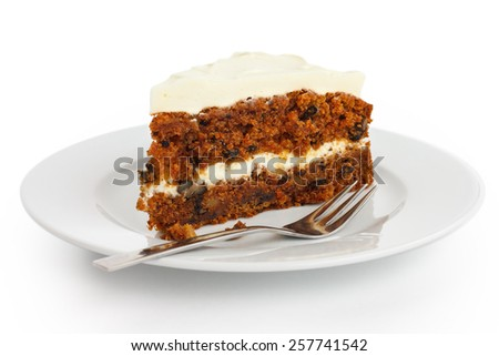 Slice of carrot cake with rich frosting. On plate. - stock photo