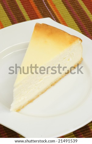 Slice of cheesecake on a kitchen plate - stock photo