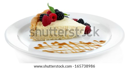 Slice of cheesecake  with berries and sauce on plate, isolated on white - stock photo