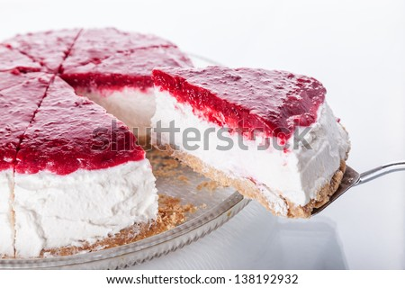 Slice of cheesecake with red fruits - stock photo