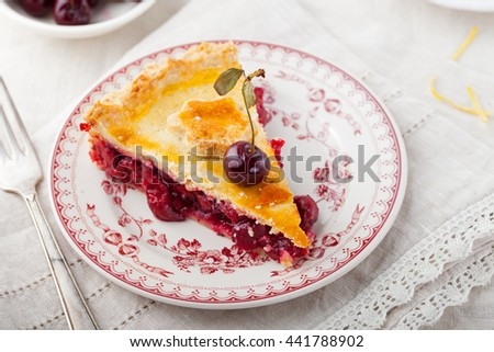 Slice of cherry pie on a ceramic plate. White textile background, Copy space - stock photo