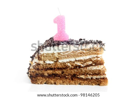 Slice of chocolate birthday cake with number one candle on a white background