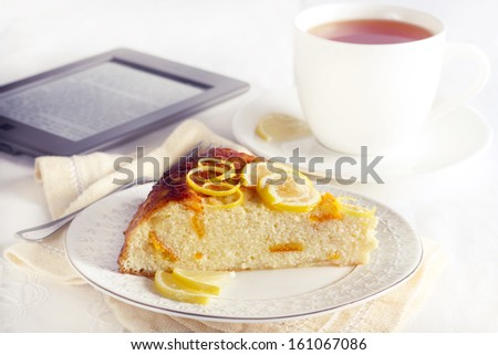 Slice of citrus cheesecake and cup of tea