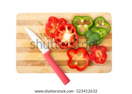 slice of colorful  bell peppers with knife