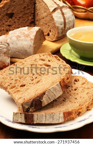 Slice of country bread on the plate   - stock photo