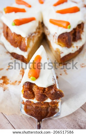 Slice of delicious carrot cake - stock photo