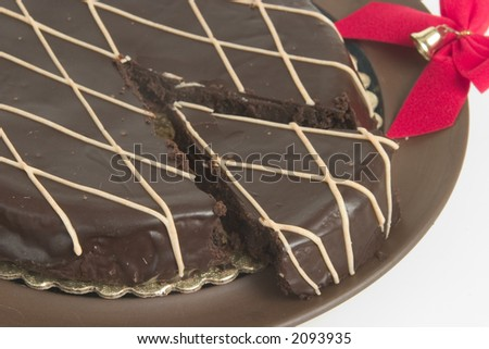 Slice of delicious flourless chocolate cake with red bow - stock photo