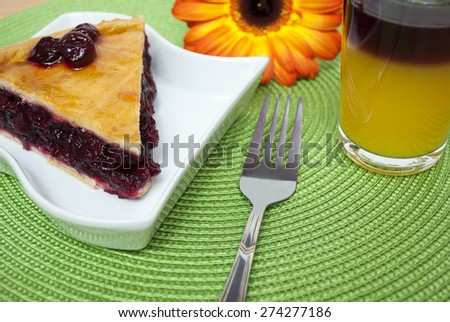 Slice of delicious homemade cherry pie on white plate - stock photo