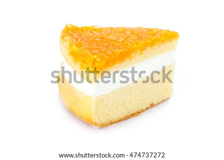 Slice of delicious orange cake on white background.