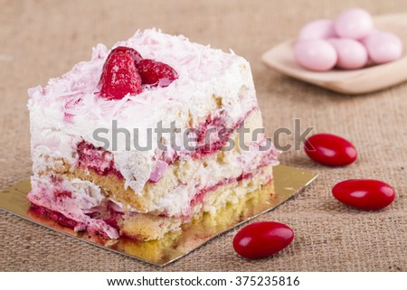Slice of delicious raspberry mousse cake made from layers of chocolate  - stock photo