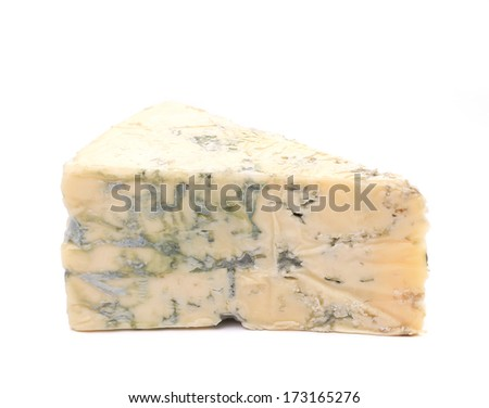 Slice of dor blue cheese. Isolated on a white background.