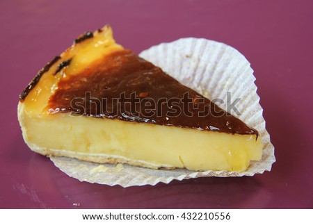 Slice of flan cake with caramel on top