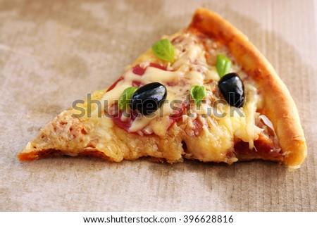 Slice of fresh baked pizza, close up - stock photo