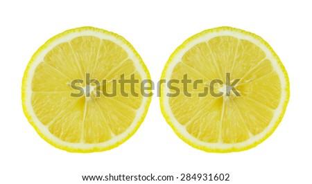 Slice of fresh lemon against white background - stock photo