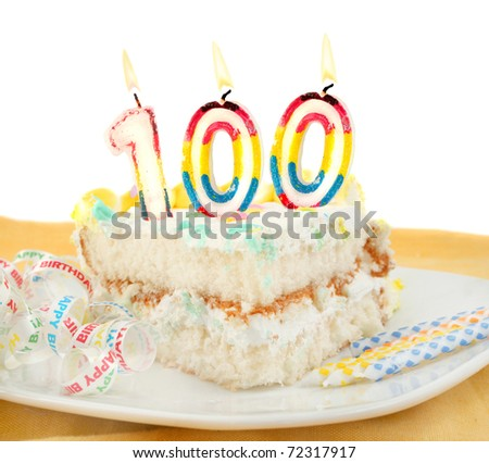 Slice of frosted festive birthday cake with candles and ribbon celebrating 100 year old birthday or anniversary - stock photo