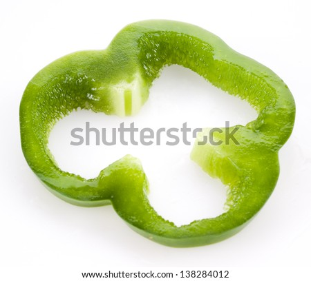 Slice of green bell pepper isolated on white - stock photo