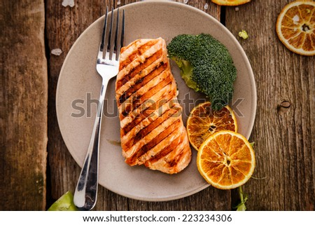 Slice of grilled salmon on a dish - stock photo