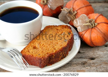 Slice of homemade pumpkin bread with a cup of coffee.