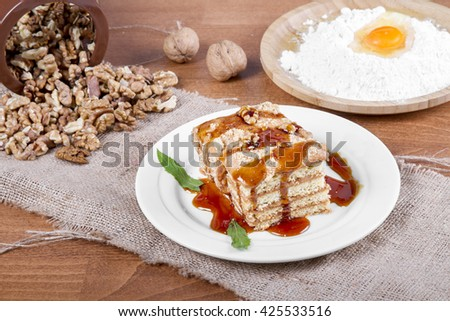 Slice of homemade tasty carrot and walnut sponge cake with pastry cream  - stock photo
