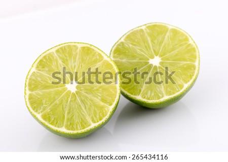 slice of lime isolated on white background - stock photo