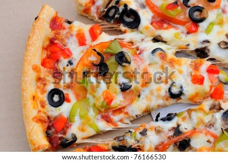 Slice of mushroom and vegetable pizza baked with fresh ingredients. - stock photo