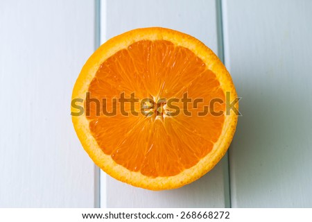 Orange cross section stock images royalty free images vectors slice of orange isolated on table background malvernweather Images