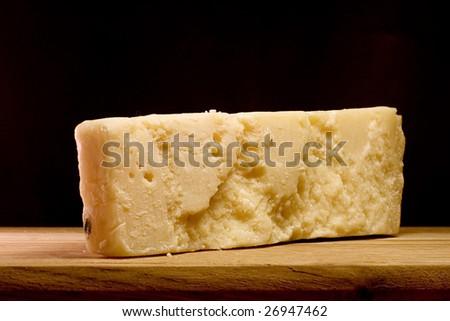 Slice of Parmesan cheese, closeup - stock photo