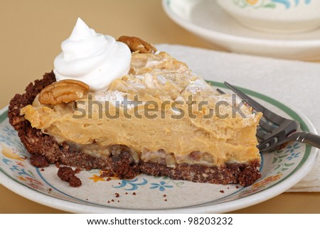 Slice of peanut butter pie with whipped cream on a plate