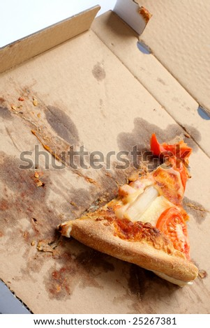 slice of pizza in a takeaway box - stock photo