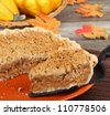 Slice of pumpkin streusel pie being served - stock photo
