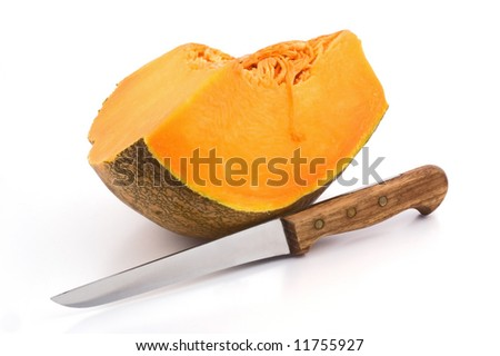 Slice of pumpkin with knife on white background
