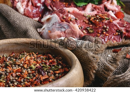 slice of raw meat in the seasoning is prepared for cooking - stock photo