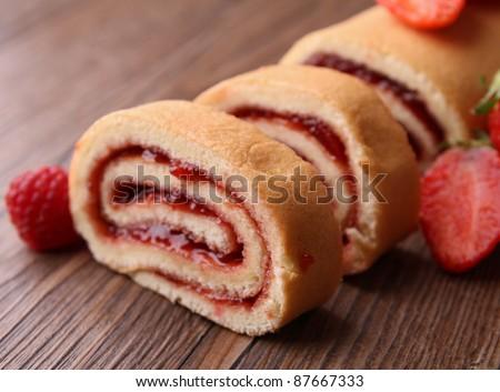 slice of swiss roll and jam - stock photo