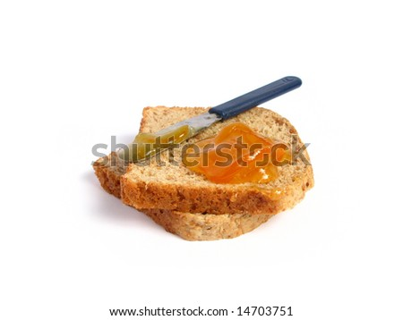 Slice of toast with orange marmalade, in a white background.