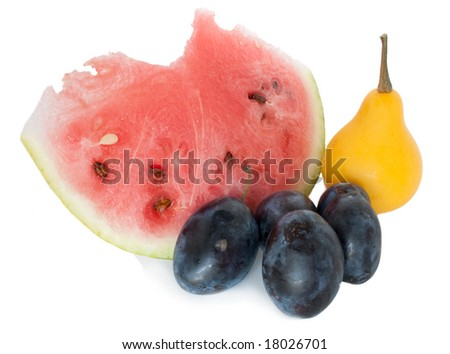 Slice of water-melon, pear, plum on a white background - stock photo