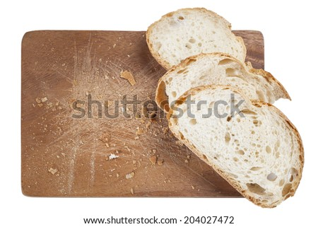 Slice of white bread on a wooden board