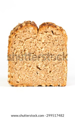 Slice of whole grain bread on white background - stock photo