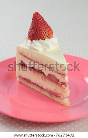Slice piece of Strawberry shortcake on pink dish - stock photo