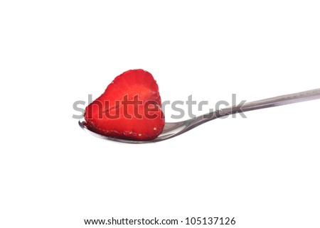 Slice strawberries and whipped cream on a spoon